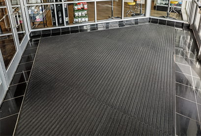 Entrance Mats Stop Dirt At The Door By Tring Debris Underneath Mat And Are Slip Resistant Removing Water From Shows Reducing Slipping Hazards